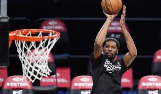 Brooklyn Nets forward Kevin Durant shoots during pregame warmups before a preseason NBA basketball game against the Washington Wizards, Sunday, Dec. 13, 2020, in New York. (AP Photo/Kathy Willens)