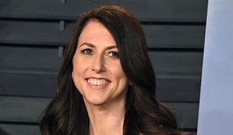 In this March 4, 2018 file photo, then-MacKenzie Bezos arrives at the Vanity Fair Oscar Party in Beverly Hills, Calif. A donation from author and philanthropist MacKenzie Scott to Virginia State University has become the largest single donor gift in the historically Black colleges history. The $30 million donation by Scott was announced Tuesday, Dec. 15, 2020, in a post that detailed the nearly $4.2 billion in gifts given to nonprofit organizations by the philanthropist in 2020. (Photo by Evan Agostini/Invision/AP, File)  **FILE**