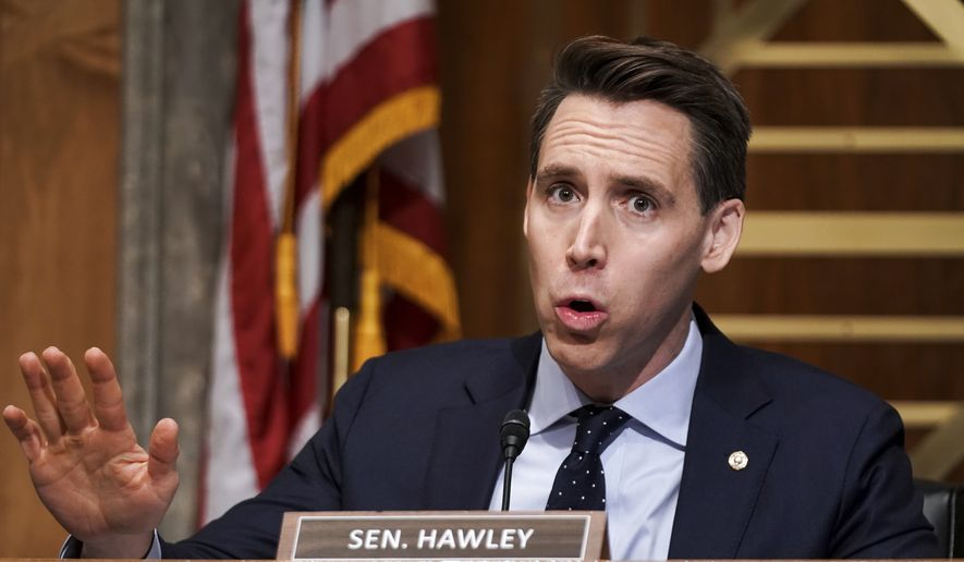 Sen. Josh Hawley, R-Mo., asks questions during a Senate Homeland Security & Governmental Affairs Committee hearing to discuss election security and the 2020 election process on Wednesday, Dec. 16, 2020, on Capitol Hill in Washington. (Greg Nash/Pool via AP) **FILE**