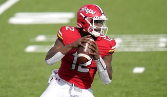 Maryland quarterback Lance LeGendre looks to pass against Rutgers during the first half of an NCAA college football game, Saturday, Dec. 12, 2020, in College Park, Md. (AP Photo/Julio Cortez)