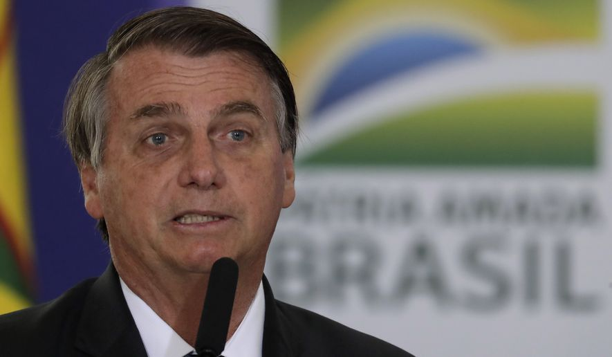 Brazilian President Jair Bolsonaro speaks during a ceremony to present his nation's National Vaccination Plan Against COVID-19 at Planalto presidential palace in Brasilia, Brazil, Wednesday, Dec. 16, 2020. (AP Photo/Eraldo Peres)