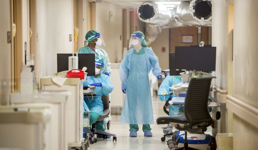 Medical personnel work inside the COVID-19 unit at University Hospital in Augusta, Ga., Wednesday, Dec. 16, 2020. COVID-19 cases nationwide have been increasing in recent weeks. (Michael Holahan/The Augusta Chronicle via AP)