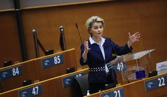 European Commission President Ursula von der Leyen addresses European lawmakers during a plenary session at the European Parliament in Brussels, Wednesday, Dec. 16, 2020. Von der Leyen said Wednesday she saw clear progress in the trade talks with the UK, turning a post-Brexit deal from a fleeting possibility into an ever more realistic possibility. (AP Photo/Francisco Seco)