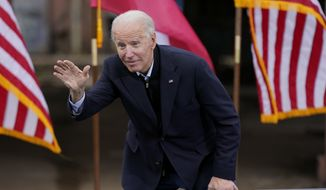 President-elect Joe Biden waves to supporters after speaking at a drive-in rally for Georgia Democratic candidates for U.S. Senate Raphael Warnock and Jon Ossoff, Tuesday, Dec. 15, 2020, in Atlanta. (AP Photo/Patrick Semansky)