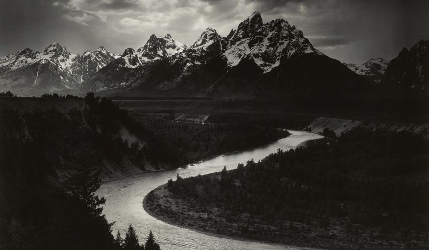 """This 1942 Ansel Adams photo provided by Sotheby's and The Ansel Adams Publishing Rights Trust shows, a West Texas oilman's mural-sized print of Ansel Adams' photo, """"The Grand Tetons and the Snake River, Grand Teton National Park, Wyoming."""" Sotheby's New York, the auction house, said Tuesday, Dec. 15, 2020, that the print sold for $988,000, a record price for Adams at auction. (Ansel Adams/The Ansel Adams Publishing Rights Trust/Sotheby's via AP)"""
