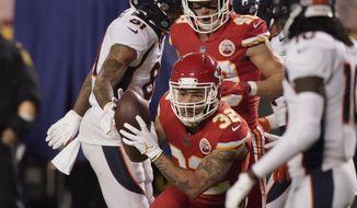 Kansas City Chiefs strong safety Tyrann Mathieu (32) intercepts a Denver Broncos quarterback Drew Lock pass in the first half of an NFL football game in Kansas City, Mo., Sunday, Dec. 6, 2020. (AP Photo/Charlie Riedel)