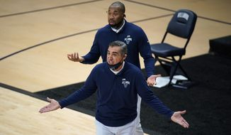 Villanova head coach Jay Wright reacts to a call during the first half of an NCAA college basketball game against Butler, Wednesday, Dec. 16, 2020, in Villanova, Pa. (AP Photo/Matt Slocum)