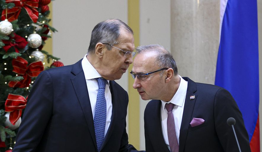 In this photo released by Russian Foreign Ministry Press Service, Russian Foreign Minister Sergey Lavrov, left, speaks to Croatia's Foreign Minister Gordan Grlic Radman, during their joint news conference following the talks in Zagreb, Croatia, Wednesday, Dec. 16, 2020. (Russian Foreign Ministry Press Service via AP)