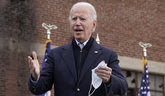 President-elect Joe Biden walks onstage to speak at a drive-in rally for Georgia Democratic candidates for U.S. Senate Raphael Warnock and Jon Ossoff, Tuesday, Dec. 15, 2020, in Atlanta. (AP Photo/Patrick Semansky)
