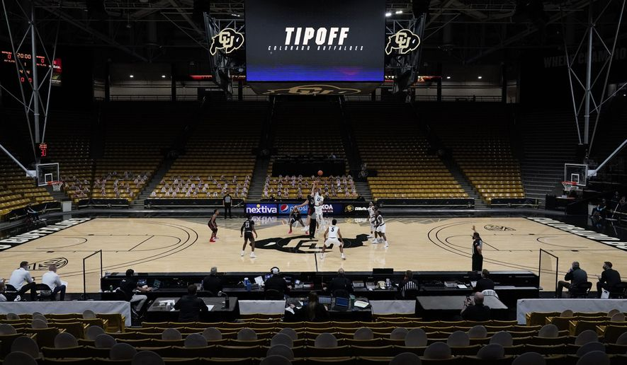 The seats are empty in the Events Center as no fans are allowed in to watch Colorado host Omaha in the first half of an NCAA college basketball game Wednesday, Dec. 16, 2020, in Boulder, Colo. (AP Photo/David Zalubowski)