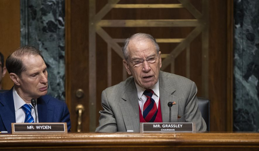 In this Tuesday, Jan. 29, 2019, file photo, Sen. Chuck Grassley, R-Iowa, center, chairman of the Senate Finance Committee, is joined at left by Sen. Ron Wyden, D-Ore., the ranking member, at a hearing on the high price of prescription drugs, on Capitol Hill in Washington. (AP Photo/J. Scott Applewhite, File)