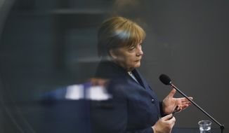 German Chancellor Angela Merkel answers questions of lawmaker about German government's policy at the parliament Bundestag, in Berlin, Germany, Wednesday, Dec. 16, 2020. Germany has entered a harder lockdown, closing shops and schools in an effort to bring down stubbornly high new cases of the coronavirus. (AP Photo/Markus Schreiber)