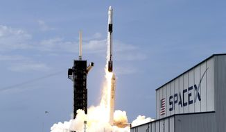 FILE - In this May 30, 2020, file photo, a SpaceX Falcon 9, with NASA astronauts Doug Hurley and Bob Behnken in the Dragon crew capsule, lifts off from Pad 39-A at the Kennedy Space Center in Cape Canaveral, Fla. For the first time in nearly a decade, astronauts blasted towards orbit aboard an American rocket from American soil, a first for a private company. (AP Photo/John Raoux, File)