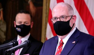 """""""Our message today is simple: You are safer at home for the holidays this year,"""" Maryland Gov. Larry Hogan said Thursday of his emergency order that requires resident who travel to or from the state to obtain a negative coronavirus test. (Associated Press)"""