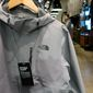 This Monday, Aug. 13, 2018, photo shows clothing for sale at The North Face store in New York. (AP Photo/Ted Shaffrey)