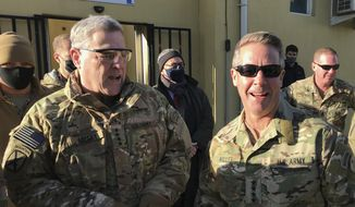 Chairman of the U.S. Joint Chiefs of Staff Gen. Mark Milley, left, talks with Gen. Scott Miller, the commander of U.S. and coalition forces in Afghanistan, Wednesday, Dec. 16, 2020 at Millers military headquarters in Kabul, Afghanistan. The top U.S. military officer has held an unannounced meeting with Taliban peace negotiators to push for a reduction in violence in Afghanistan. (AP Photo/Robert Burns)