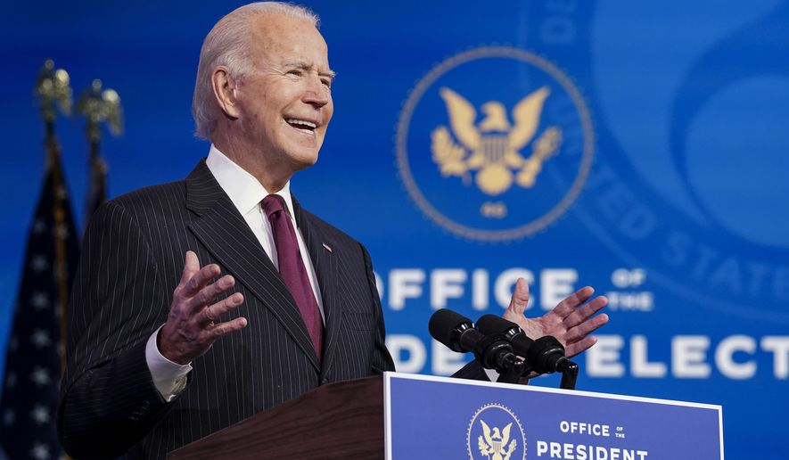 President-elect Joe Biden announces former South Bend, Ind. Mayor Pete Buttigieg as his nominee for transportation secretary during a news conference at The Queen theater in Wilmington, Del., Wednesday, Dec. 16, 2020. (Kevin Lamarque/Pool via AP) **FILE**