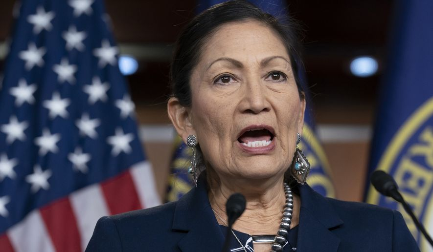 In this March 5, 2020, photo Rep. Deb Haaland, D-N.M., Native American Caucus co-chair, speaks to reporters about the 2020 Census on Capitol Hill in Washington. President-elect Joe Biden plans to nominate Haaland as interior secretary. The historic pick would make her the first Native American to lead the powerful federal agency that has wielded influence over the nation's tribes for generations. (AP Photo/J. Scott Applewhite) **FILE**