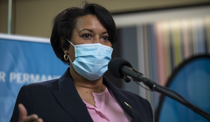 District of Columbia Mayor Muriel Bowser speaks during an event to administer the Pfizer-BioNTech vaccine for COVID-19 to frontline workers at Kaiser Permanente Capitol Hill Medical Center in Washington, Thursday, Dec. 17, 2020. (Shawn Thew/Pool via AP)