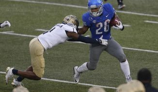 Buffalo running back Jaret Patterson (26) is tackled by Akron's Randy Cochran Jr. (1) during the first half of an NCAA college football game in Amherst, N.Y., Saturday Dec. 12, 2020. (AP Photo/Jeffrey T. Barnes)