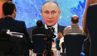 Russian President Vladimir Putin speaks via video call during a news conference in Moscow, Russia, Thursday, Dec. 17, 2020. This year, Putin attended his annual news conference online due to the coronavirus pandemic. (AP Photo/Alexander Zemlianichenko)