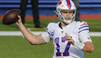 FILE - In this Nov. 29, 2020, file photo, Buffalo Bills quarterback Josh Allen passes during the first half of an NFL football game against the Los Angeles Chargers in Orchard Park, N.Y. Allen has gone from an erratic quarterback coming out of Wyoming to a precision passer in his third NFL season, leading the Bills to the cusp of their first AFC East title in a quarter century. (AP Photo/Jeffrey T. Barnes, File)