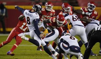 Denver Broncos kicker Brandon McManus (8) kicks a 53-yard field goal against the Kansas City Chiefs in the first half of an NFL football game in Kansas City, Mo., Sunday, Dec. 6, 2020. (AP Photo/Jeff Roberson)