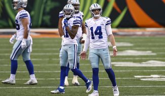 Dallas Cowboys quarterback Andy Dalton (14) reacts to an intentional grounding call in the second half of an NFL football game against the Cincinnati Bengals in Cincinnati, Sunday, Dec. 13, 2020. (AP Photo/Aaron Doster)