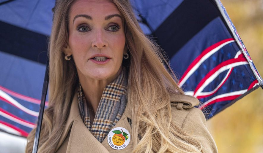 U.S. Sen. Kelly Loeffler, R-Ga., after casting her ballot during early voting in runoff elections at Chastain Park Gymnasium in Atlanta's Chastain Park neighborhood, Wednesday, Dec. 16, 2020. Democratic candidates Jon Ossoff and the Rev. Raphael Warnock are trying to to unseat Republican Sens. David Perdue and Kelly Loeffler in the runoff elections that will determine which party controls the Senate. (Alyssa Pointer/Atlanta Journal-Constitution via AP)