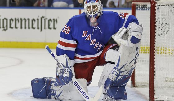 """FILE - New York Rangers' Henrik Lundqvist reacts after a save during the third period of an NHL hockey game against the Philadelphia Flyers in New York, in this Sunday, March 1, 2020, file photo. The Flyers defeated the Rangers 5-3. Star goalie Henrik Lundqvist will sit out the upcoming NHL season because of a heart condition, announcing the news a little more than two months after joining the Washington Capitals. Lundqvist posted a written statement and a videotaped one on social media Thursday, Dec. 17, 2020, saying it was a """"pretty tough and emotional day."""" The 38-year-old from Sweden was bought out by the New York Rangers after 15 seasons and signed a $1.5 million, one-year deal with Washington in October. (AP Photo/Seth Wenig, File)"""