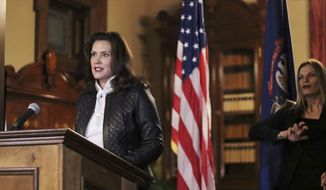 In this Oct. 8, 2020, file photo provided by the Michigan Office of the Governor, Michigan Gov. Gretchen Whitmer addresses the state during a speech in Lansing, Mich. In an indictment released Thursday, Dec. 17, a federal grand jury charged six men with conspiring to kidnap Whitmer in what investigators say was a plot by anti-government extremists angry over her policies to prevent the spread of the coronavirus. (Michigan Office of the Governor via AP, File)