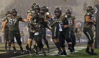 Army quarterback Tyhier Tyler celebrates after scoring a touchdown during the second half of an NCAA college football game Saturday, Dec. 12, 2020, in West Point, N.Y.  (AP Photo/Adam Hunger)