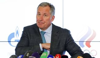 President of the Russian Olympic Committee Stanislav Pozdnyakov attends a news conference in Moscow, Russia, Thursday, Dec. 17, 2020. The Court of Arbitration for Sport confirmed Russia's flag and anthem are barred from next year's Olympics in Tokyo and the 2022 Winter Games in Beijing on Thursday. (AP Photo/Alexander Zemlianichenko)