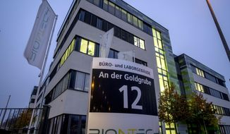"""File -- In this Tuesday, Nov.10, 2020 file photo windows are illuminated at the headquarters of the German biotechnology company BioNTech in Mainz, Germany. German company BioNTech was little-known outside the pharmaceutical industry before it teamed up with U.S. giant Pfizer for """"Project Lightspeed"""" that beat major rivals in the race to put the first thoroughly vetted vaccine on the market. (AP Photo/Michael Probst, file)"""