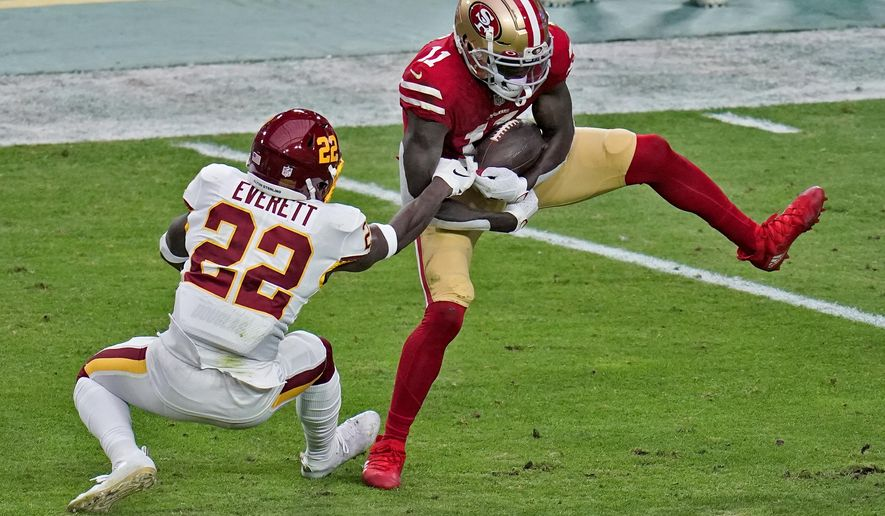San Francisco 49ers wide receiver Brandon Aiyuk (11) makes a catch as Washington Football Team free safety Deshazor Everett (22) defends during the first half of an NFL football game, Sunday, Dec. 13, 2020, in Glendale, Ariz. (AP Photo/Ross D. Franklin)