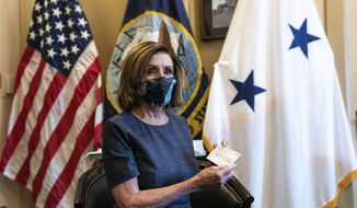 Speaker of the House Nancy Pelosi, D-Calif., sits after receiving a Pfizer-BioNTech COVID-19 vaccine shot in Washington, Friday, Dec. 18, 2020. (Anna Moneymaker/The New York Times via AP, Pool)