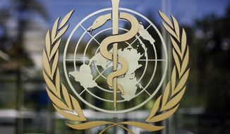"""FILE - In this June 11, 2009, file photo, the logo of the World Health Organization is seen at the WHO headquarters in Geneva, Switzerland. The head of the World Health Organization says on Friday, Dec, 18, 2020 the U.N. health agency's program to help get COVID-19 vaccines to all countries in need, has gained access to nearly 2 billion doses of several """"promising"""" vaccine candidates. None of the agreements currently include the vaccines by Moderna or Pfizer-BioNTech, which is already in use in the United States, Canada and Britain. (AP Photo/Anja Niedringhaus, File)"""