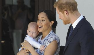 """FILE - In this Wednesday, Sept. 25, 2019 file photo, Britain's Prince Harry and Meghan, Duchess of Sussex, holding their son Archie, meet with Anglican Archbishop Emeritus, Desmond Tutu, and his wife Leah in Cape Town, South Africa. The Duchess of Sussex has settled a claim against Splash News and Picture Agency, with the agency agreeing not to take any photos of her, her husband the Duke of Sussex or their son Archie, should it come out of administration, the High Court has heard. Meghan brought privacy and data protection claims against Splash in March this year over """"long lens"""" photographs taken of her and her son in a Canadian park in January. (Henk Kruger/African News Agency via AP, Pool, File)"""