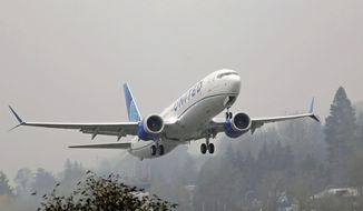FILE - In this Wednesday, Dec. 11, 2019 file photo, a United Airlines Boeing 737 Max airplane takes off in the rain at Renton Municipal Airport in Renton, Wash. Boeing improperly influenced a test designed to see how quickly pilots could respond to malfunctions on the Boeing 737 Max, and Federal Aviation Administration officials may have obstructed a review of two deadly crashes involving the plane, Senate investigators say. In a report released Friday, Dec. 18, 2020 the Senate Commerce Committee also said the FAA continues to retaliate against whistleblowers.(AP Photo/Ted S. Warren, File)