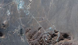 This Nov. 4, 2020, satellite photo by Maxar Technologies shows Iran's Fordo nuclear site. Iran has begun construction on a site at its underground nuclear facility at Fordo amid tensions with the U.S. over its atomic program, satellite photos obtained Friday, Dec. 18, 2020, by The Associated Press show. (Maxar Technologies via AP)