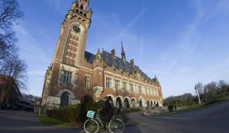 FILE- In this Monday, Feb. 18, 2019, file photo the Peace Palace, which houses the International Court of Justice, or World Court, is seen in The Hague, Netherlands. The United Nations' highest court ruled Friday Dec. 18, 2020, that it will intervene to settle a decades-old border dispute between Latin American neighbors Guyana and Venezuela. The decision by the International Court of Justice means it will now move to judge the merits of the case, which will likely take months or years. (AP Photo/Peter Dejong, File)