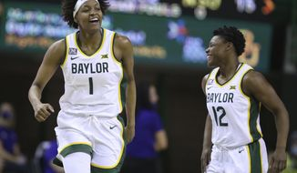 Baylor forward NaLyssa Smith, left, reacts to her score against Northwestern with teammate guard Moon Ursin, right, in the first half of an NCAA college basketball game, Friday, Dec. 18, 2020, in Waco, Texas. (Rod Aydelotte/Waco Tribune-Herald via AP)