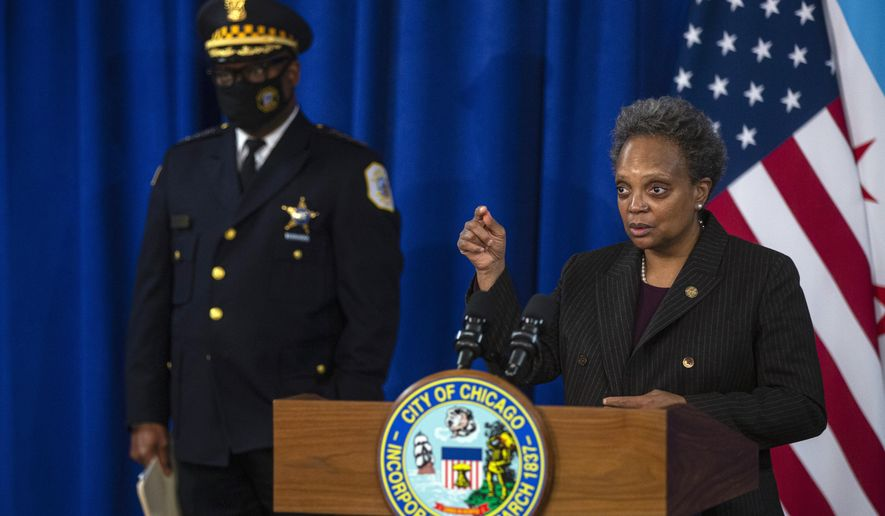 Chicago Mayor Lori Lightfoot speaks during a press conference at City Hall on Thursday, Dec. 17, 2020. She discussed the video of Chicago police mistakenly searching the wrong house and said the city will no longer withhold video from residents seeking police records of their own incidents. (Anthony Vazquez/Chicago Sun-Times via AP)