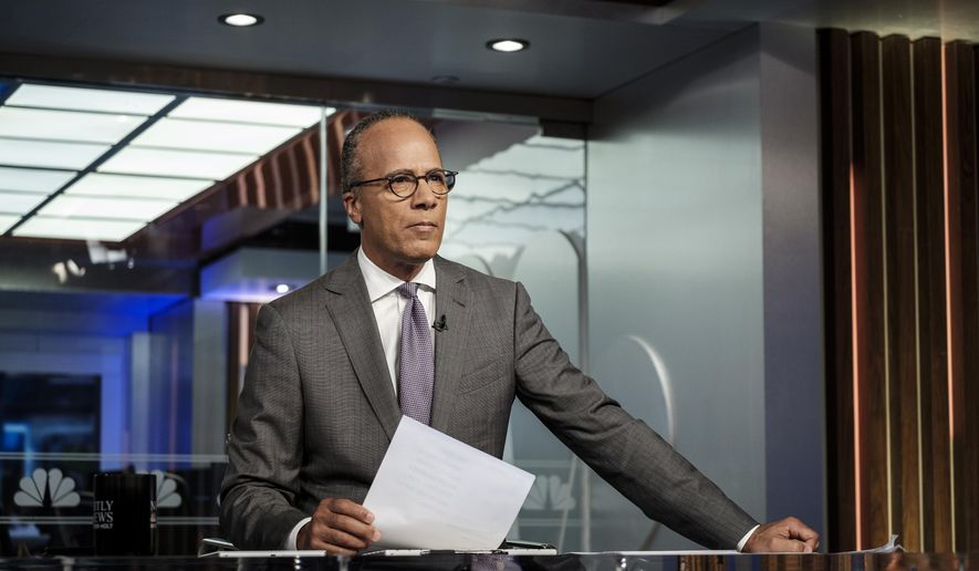 """NBC's Lester Holt appears on the set in New York on Tuesday Aug. 7, 2018. The """"NBC Nightly News"""" anchor occasionally ends his broadcasts now with commentaries, an unusual departure for network evening newscasts that have a lengthy track record of playing it straight. Holt's commentaries trend toward the non-controversial, with a central theme of trying to find common ground that will pull Americans together.  (Christopher Dilts/NBC Universal via AP)"""