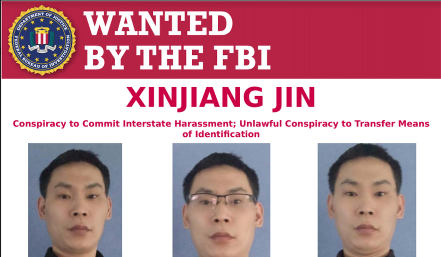 An FBI wanted poster for Chinese national Xinjiang Jin, who is accused of attempting to disrupt an online protest against the People's Republic of China, is shown here.