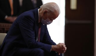 In this Monday, June 1, 2020, photo, Democratic presidential candidate and former Vice President Joe Biden bows his head in prayer as he visits Bethel AME Church in Wilmington, Del. Biden will be just the second Roman Catholic president in U.S. history, after John F. Kennedy. (AP Photo/Andrew Harnik) ** FILE **