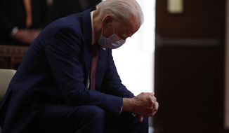 FILE - In this Monday, June 1, 2020 file photo, Democratic presidential candidate, former Vice President Joe Biden bows his head in prayer as he visits Bethel AME Church in Wilmington, Del. Biden will be just the second Roman Catholic president in U.S. history, after John F. Kennedy. (AP Photo/Andrew Harnik)