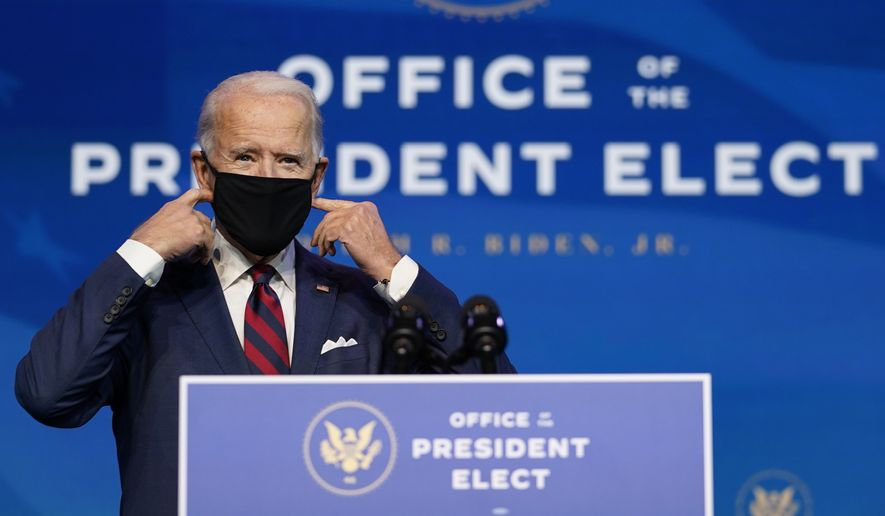 President-elect Joe Biden arrives to announce climate and energy nominees and appointees at The Queen Theater in Wilmington Del., Saturday, Dec. 19, 2020. (AP Photo/Carolyn Kaster)