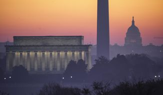 In this Nov. 8, 2020, file photo, the Washington skyline is seen at dawn with from left the Lincoln Memorial, the Washington Monument, and the U.S. Capitol. (AP Photo/J. Scott Applewhite, file)  **FILE**
