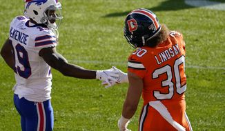 Buffalo Bills wide receiver Isaiah McKenzie, left, greets Denver Broncos running back Phillip Lindsay before an NFL football game Saturday, Dec. 19, 2020, in Denver. (AP Photo/Jack Dempsey)